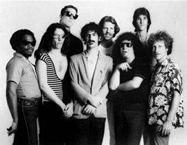 From left to right: Ray White, Steve Vai, Scot Thunes, Frank Zappa, Robert Martin, Tommy Mars, Chad Wackerman & Ed Mann